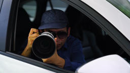 4K Spy, paparazzi or detective in the car, shooting on camera. Shot on RED EPIC Live Action