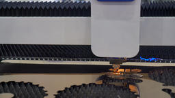 Cut sheet metal at workshop. Modern tool in heavy industry. Dangerous job. High GIF