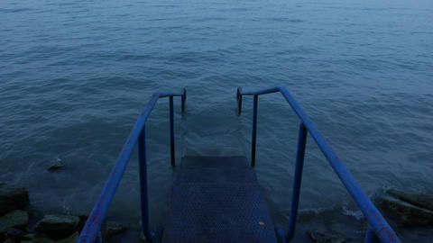 4K Iron Stairs Leading into Lake Early Morning 1 Footage