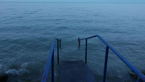 4K Iron Stairs Leading into Lake Early Morning 3 cinematic motion Footage
