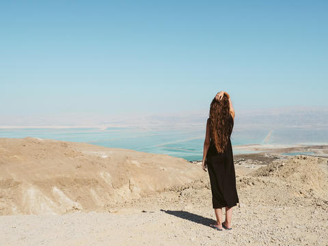 Young woman standing on a mountain Photo