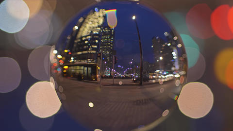City downtown street view in the evening as seen through the glass ball Footage
