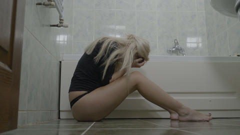 Upset hot blonde teenager female wearing thong crying in the bathroom after Footage