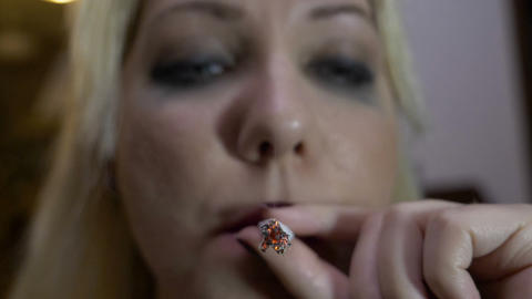 Portrait of an orphan girl lighting a marijuana joint inhaling and exhaling the Footage