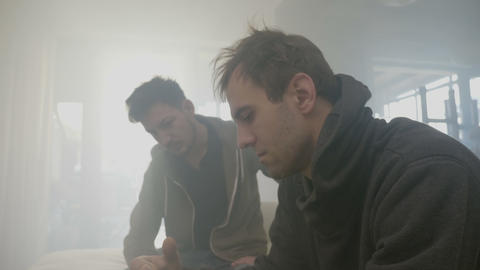 Young drug addicted boys consumers inhaling and exhaling smoke from a marijuana Live Action