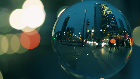 City downtown street crosswalk in the evening as seen through the glass ball Footage