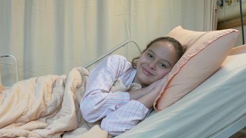Asian American tween girl in hospital bed Footage