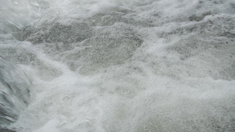 Close up of water stream with white and transparent bubbles Footage