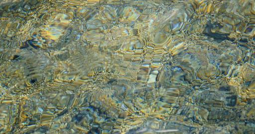 Golden water texture seamless loop Live Action