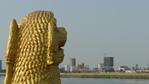 Golden statue at the riverside of Phnom Penh Footage