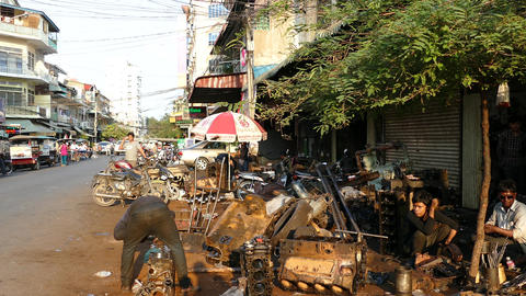 Motorbike and car repair shop on the street downtown Phnom Penh Footage