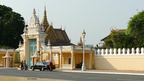 Monk walking in front of the Royal Palace in Phnom Penh Footage