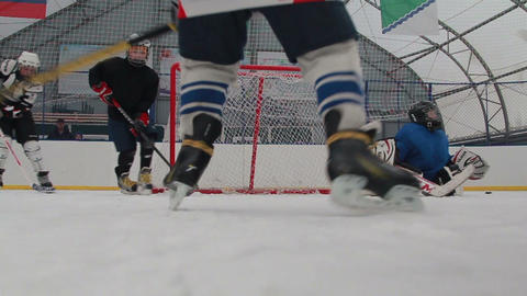 training young hockey players Live Action