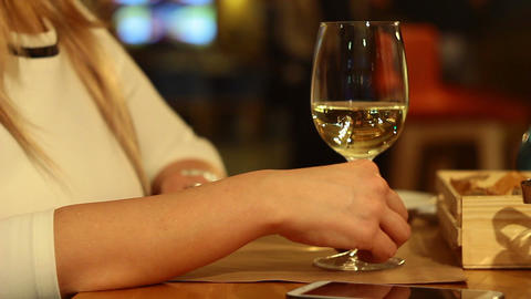 A Young Girl Drinks Wine Restaurant stock footage