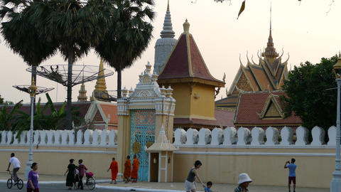 Monks walking in front of the Royal Palace Footage