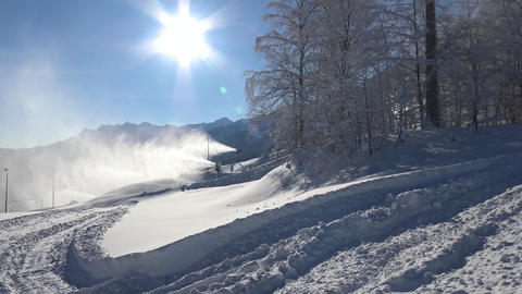 Snow guns blow snow on the slopes of the ski resort of Krasnaya Polyana Footage