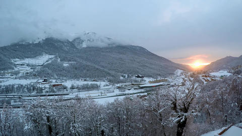 Picturesque sunset in a valley in the ski resort of Krasnaya Polyana. Timelapse Live Action