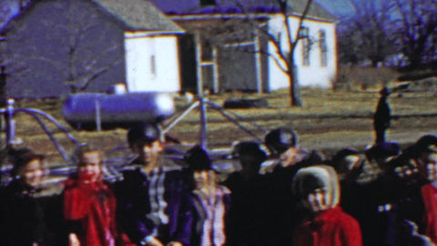 1958: Country schoolyard kids gather playground rural lifestyle Footage