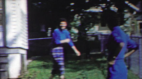 1958: Horny teenage girl chasing handsome man front yard house Footage