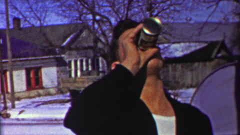 1958: Man slams beer can crushes in with hands smoking cigar Footage