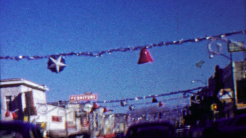 1958: Christmas holiday decoration red bells blue stars downtown mainstreet Footage