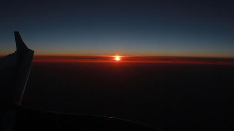 The Plane In The Sky. Airplane Window View At Sunset Sky stock footage
