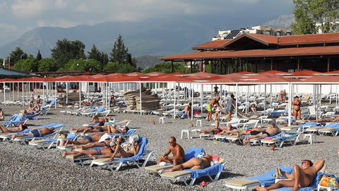 People relax on the beach. Turkey Footage