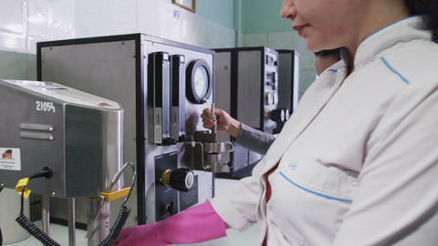 Scientific Laboratory Employees Work with Devices Footage