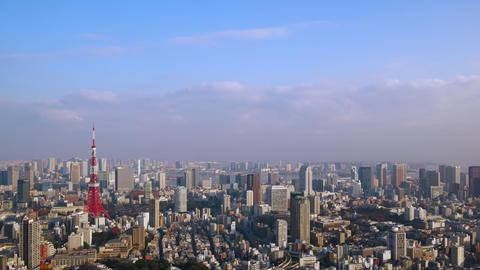 Timelapse - Scenery of Tokyo becoming sunny from clouds Tilt up ビデオ