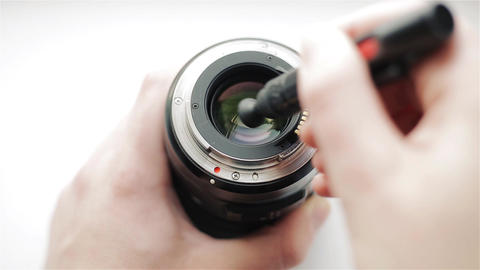 The photographer's hands clean the back side of the modern lens from dirt and Footage