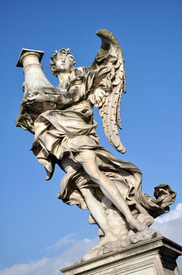 Marble statue of Angel against blue sky Photo