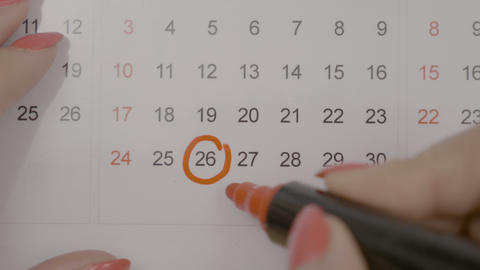 Top view of woman hands signing birth day on calendar and counting the days to Footage