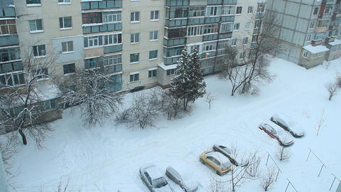 Snowy weather. Snow covered yard. View to winter European city ライブ動画