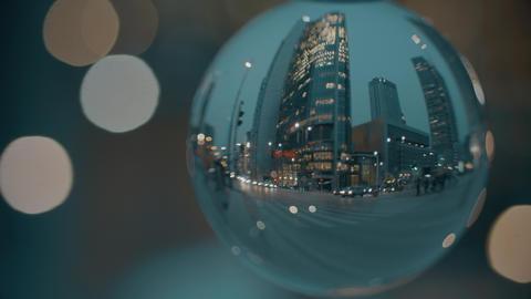 City street as seen through the glass ball Footage