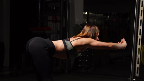 Young woman stretching her arms before gym workout Footage
