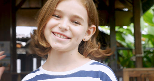Portrait of a beautiful young happy confident 11 - 12 year old girl smiling and Footage