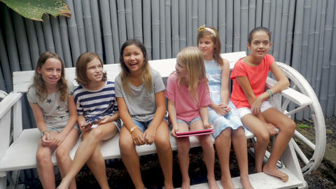 Push in of a diverse multi racial group of young girls smiling and laughing in Live Action