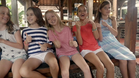 Diverse multi racial Asian and Caucasian group of six young happy smiling girls Live Action