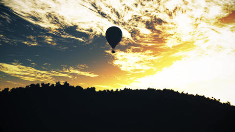 4K Hot Air Balloons Over Lush Natural Wilderness Jungle In The Sunset Sunrise 10 stock footage