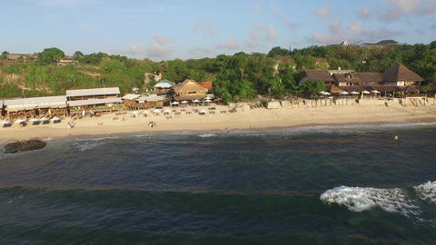 DJI_0031_Flying Over The Waves To The Seaside Restaurants At The Balangan Beach, stock footage