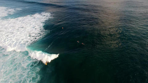 Aerial view of a short surf ride on a wave Footage