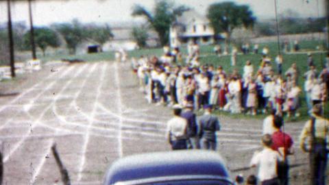 1958: High school track boys track running race turning corner Footage