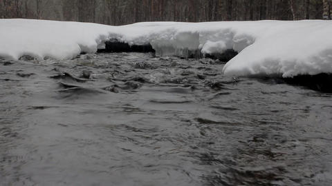 Beginning of winter. Snowing over frozen river Footage