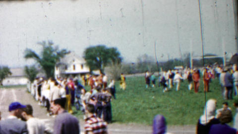 1958: High school track meet crowds wait for next event Footage
