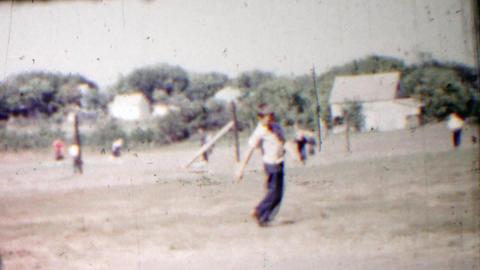 1958: Physically challenged child practice walking schoolyard playground Footage