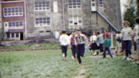 1958: Schoolyard kids practice long jump athletic sports competition Footage