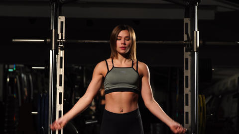 Sport, activity. Cute woman with skipping rope. Muscular woman black background Footage