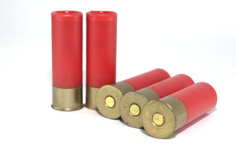 Five old shotgun ammunition for Soviet shotgun on white background Fotografía