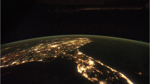 Satellite flying over the Earth at night Archivo