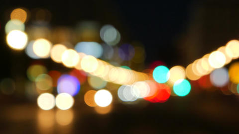 Shot of out of focus car lights in a busy city center Footage